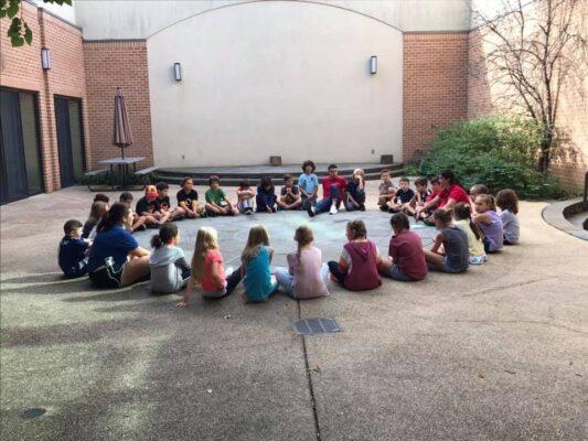 Children in circle in courtyard