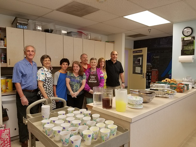 TBA volunteers serving dinner at shelter - 2019